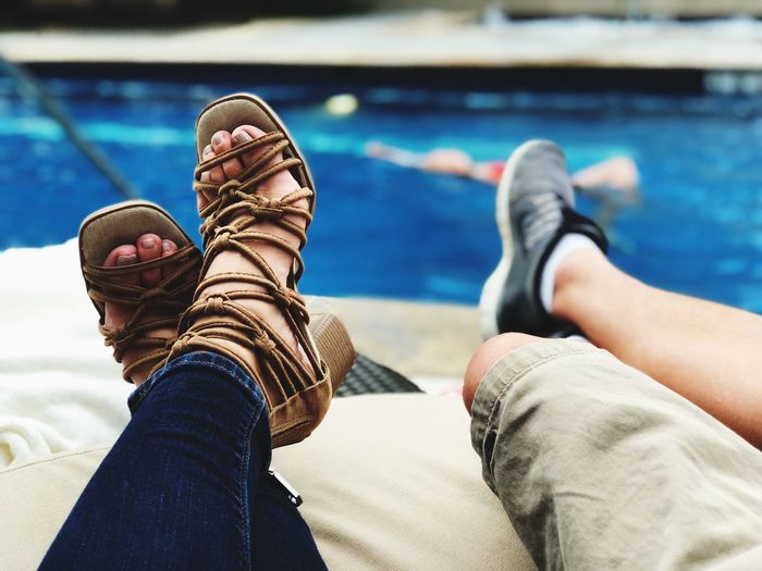 Pool side happiness!!! Love EyeEm Selects Human Leg Low Section Real People Body Part Human Body Part Personal Perspective Human Limb Togetherness Legs Crossed At Ankle Women Leisure Activity People Jeans Day Lifestyles Adult Shoe Relaxation Indoors  Human Foot