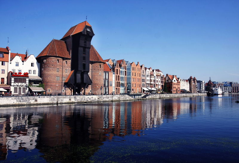 The old town of Gdansk by the Motlawa river with Old Crane Bricks Building Exterior Built Structure Cityscape Crane Famous Place Gothic History Motława Old Town Postcard Reflection River Summer Travel Destinations Wallpaper Water Waterfront
