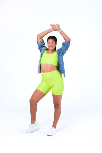White Background Studio Shot Lifestyles Zumba Zumba Fitness Green Green Color Neon Color Happiness Happy Fitness Model Dancing Dance Latin Woman Latina Argentina Gym Fashionable Movement Euphoria Cute Jean Jacket Sportive Sportivegirl
