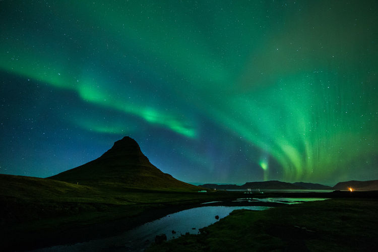 Scenic View Of Aurora Polaris Over Kirkjufell Mountain