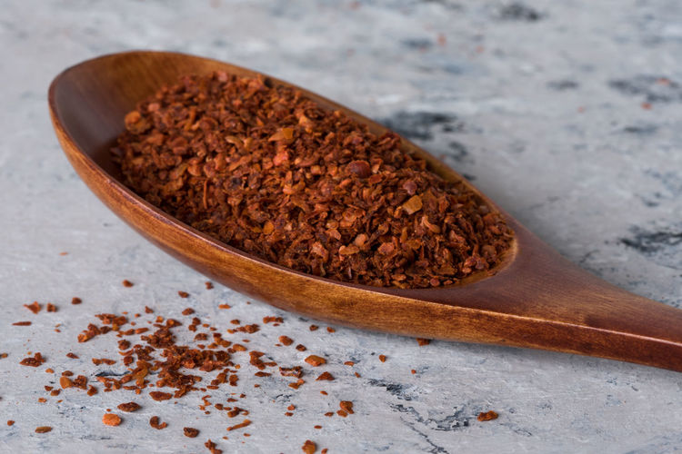 Close-up of spice in spoon on table