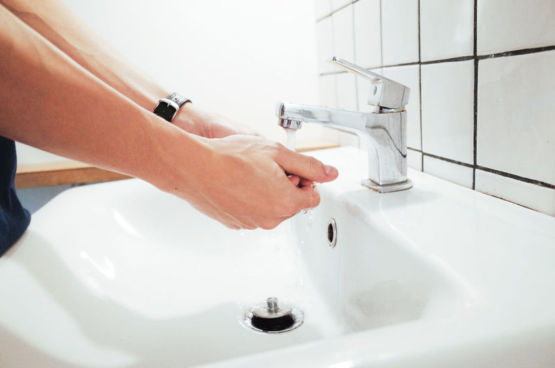 Bathroom Sink Human Hand Domestic Bathroom Hand Faucet Hygiene Domestic Room Human Body Part Household Equipment Cleaning Home Bathroom Sink One Person Indoors  Water Washing Running Water Washing Hands Body Part Finger Human Limb