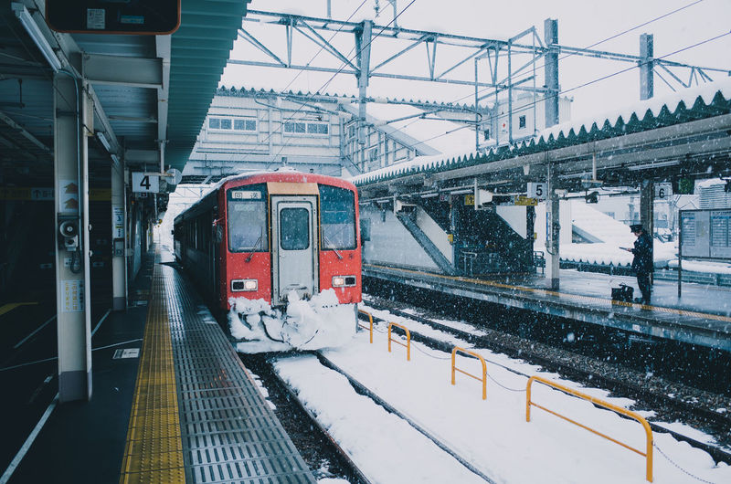 Train at railroad station during winter