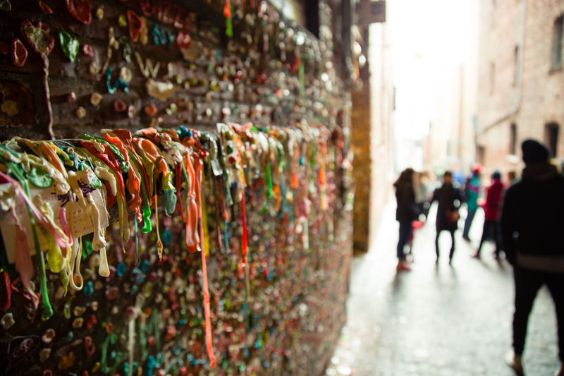 People in the bubblegum alley in Seattle's Pike Place Market. Bubblegum Bubblegum Wall Candy Chewing Gum Chewing Gum Wall Color Colorful Colourful Colours Disgusting  Gross Gum Gum Wall People Pike Place Pike Place Market Seattle Smelly Tourists Tradition Travel Travel Destinations Traveling Unhygienic Wall Capture Tomorrow