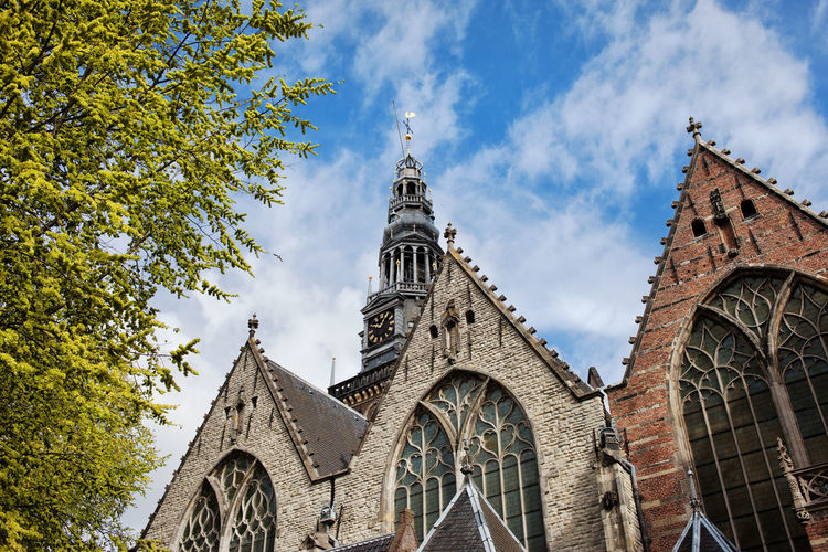 Old Church (Dutch: Oude Kerk), the oldest building in Amsterdam, Holland, Netherlands Amsterdam Architecture Christian Christianity Church Gothic Gothic Architecture Historical Building Netherlands Amsterdamcity Architecture Building Exterior Built Structure Europe Gothic Style Historic Holland Landmark Monument Old Buildings Old Church Oude Kerk Place Of Worship Religion Religious Architecture