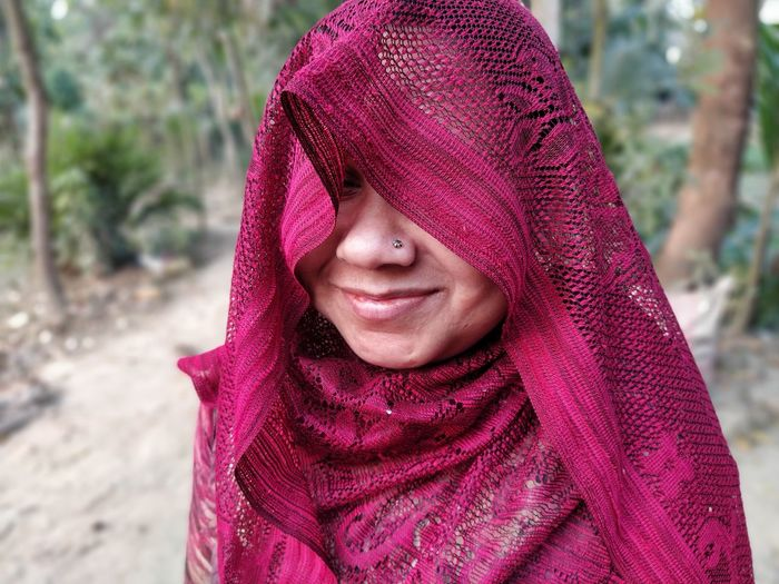 Close-up of smiling woman wearing scarf