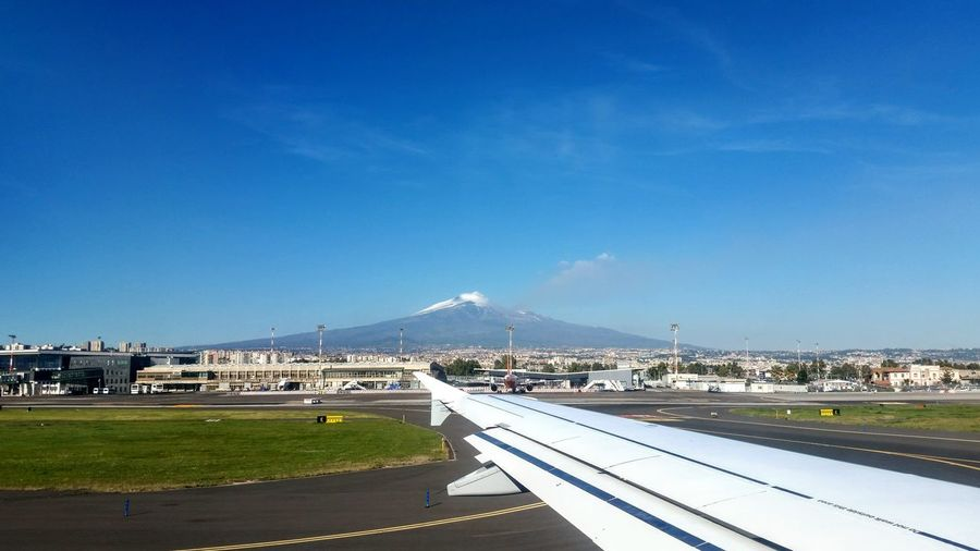 Etna Catania, Sicily Going Home It's About The Journey City Cityscape Mountain Sea Beach Water Clear Sky Road Airport Runway