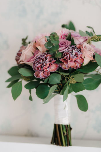 Close-up of bouquet in vase on table