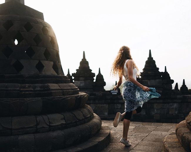 Borobudur Temple Borobudur Temple, Indonesia Temple Chedi Temples INDONESIA Curly Hair Twirling Travel Girl