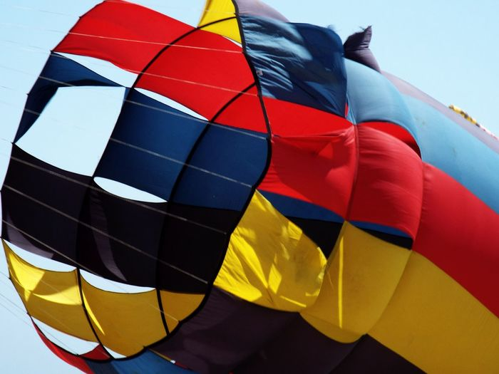 Giant Kite Colorful Beach Kite Flying Giant Kite Giant Kites Beachphotography Beach Photography Sky Blue Red Yellow Blue Sky EyeEm Selects Hot Air Balloon Ballooning Festival Multi Colored Flying Air Vehicle Sky Close-up Gliding Kite Traditional Festival
