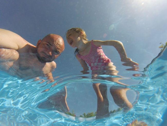 Water Family With One Child Leisure Activity Real People Swimming Pool Lifestyles Childhood Vacations Go Pro Photography