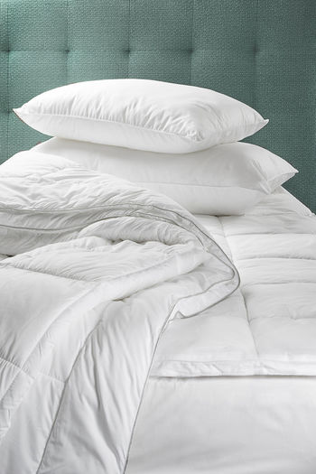 Pillow and duvet on bed