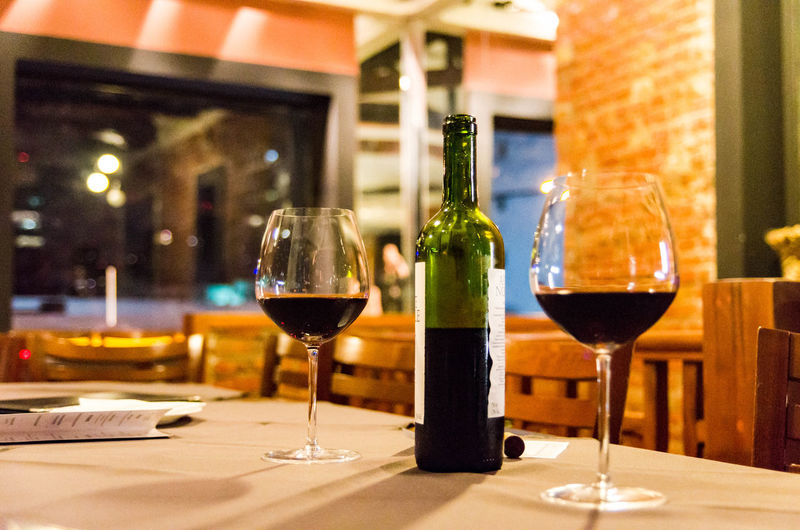 Wine glass on table in restaurant