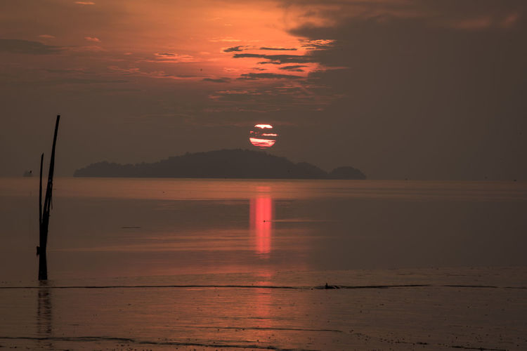 View of calm sea at sunset