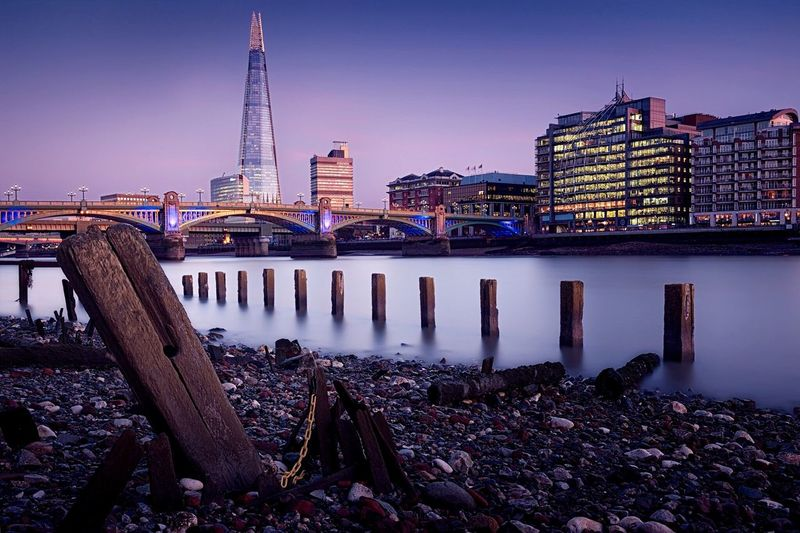 Thames river by the shard against sky at dusk