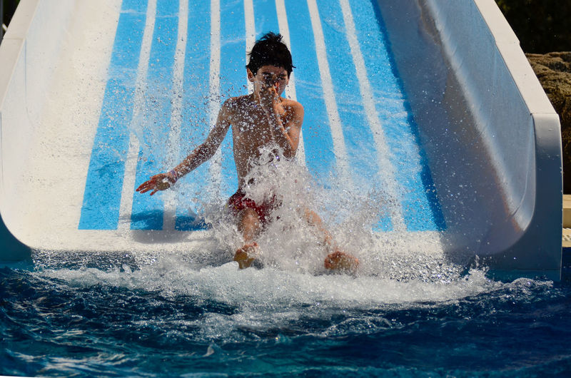 View of boy on water slide