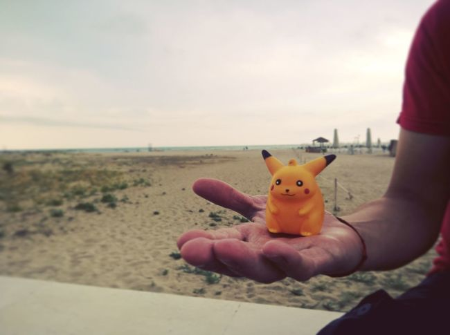 This is not augmented reality Pokemons Pokemon Go Augmented Reality Toy Hand Picachu Beach Promenade Summer Seaside Catchemall Hanging Out Summer 2016 Having Fun Having A Good Time Beach Day Afternoon Enjoying Life