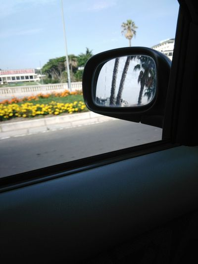 Rear-view Mirror Car Point Of View Looking Through Window