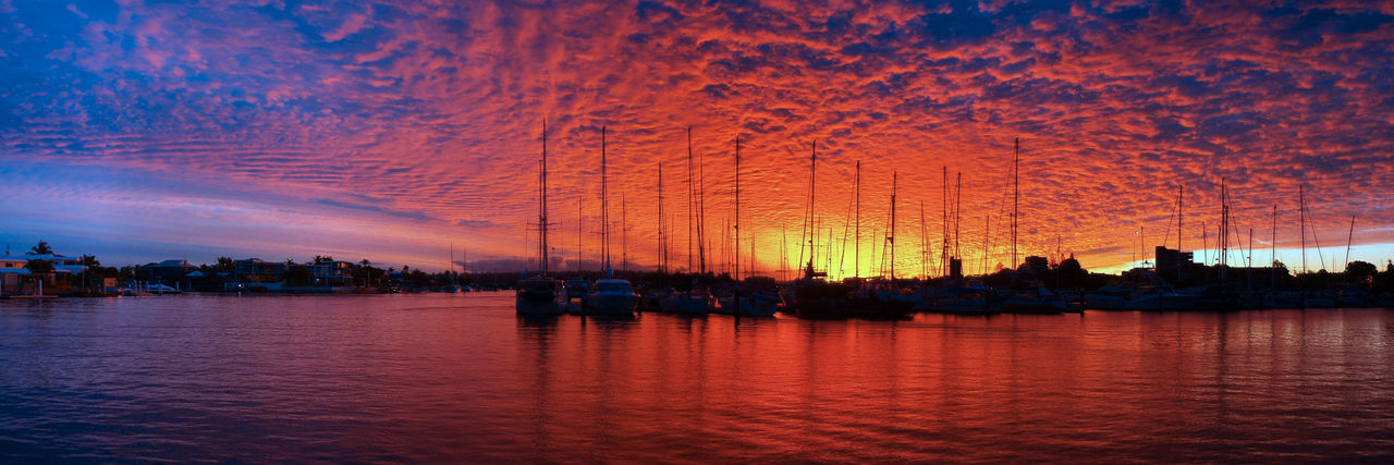 Crimson and Blue marina Sunset with water reflections and boats in silhouette. Beauty In Nature City Cloud - Sky Crimson Dramatic Sky Illuminated Maria Multi Colored Nature Nautical Vessel Night No People Outdoors Reflection River Scenics Sky Sunset Tranquility Travel Destinations Water Waterfront Yachts