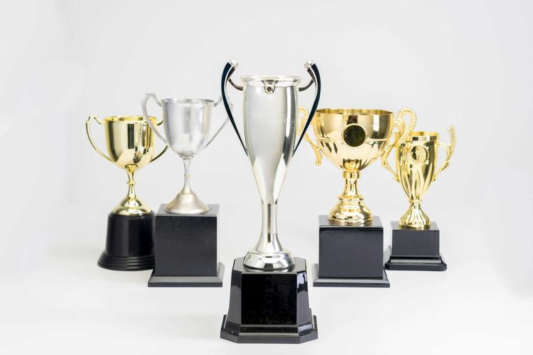 Variety of Trophy Cup on white background Trophy AWARD Success Achievement Indoors  Studio Shot Gold Colored Still Life No People Winning White Background Competition Shiny Variation Side By Side Choice Gold Metal Medal Copy Space Silver Colored
