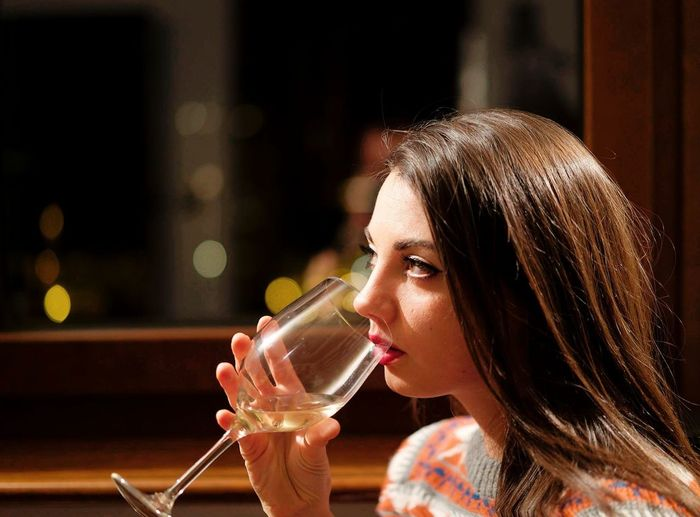 Close-Up Of Beautiful Woman Having Wine