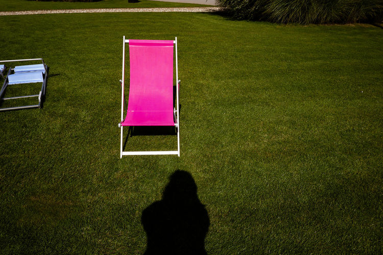 High angle view of people relaxing on chair in lawn