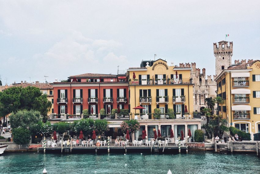 Deluxe Vacations Sirmione Summer Italy Luxury Board Walk By The Sea Resort Recreation  Travel Holiday Vacations Resort Hotel Water Built Structure Building Exterior Architecture Sky Waterfront Nature Nautical Vessel Building City