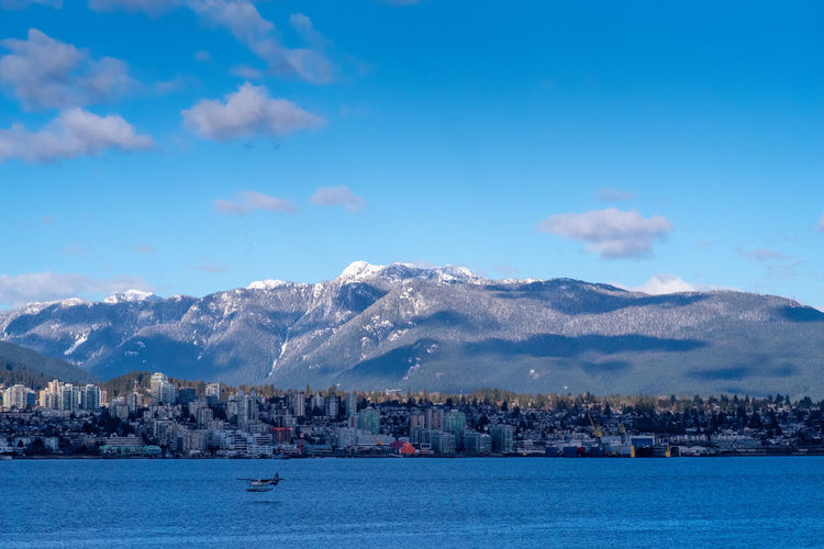 Snowy North Shore Snow Mountains Winter North Shore North Vancouver Vancouver British Columbia Canada City Cityscape Water Mountain Snow Blue Lake Winter Urban Skyline Sky