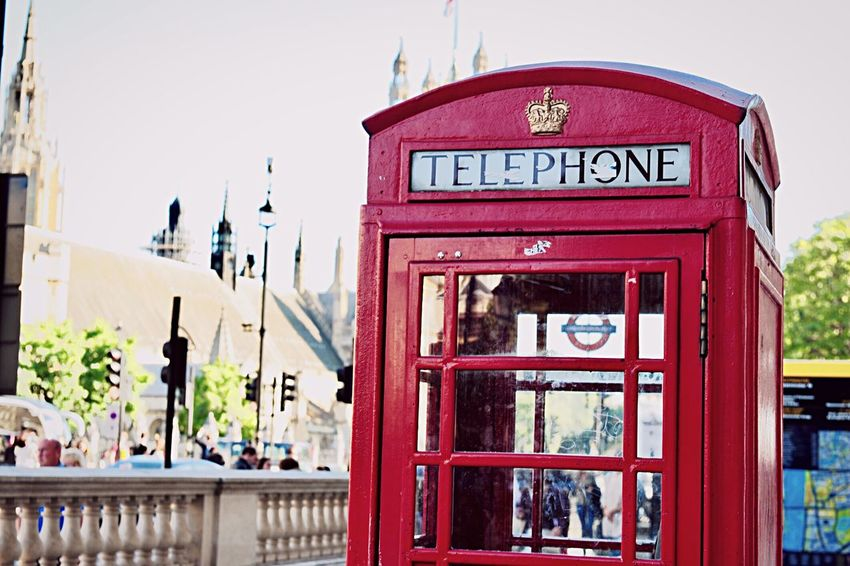 EyeEm LOST IN London Telephone Booth Communication Red Outdoors Pay Phone Text Day Telephone Travel Destinations City Architecture Built Structure Building Exterior No People Sky Close-up