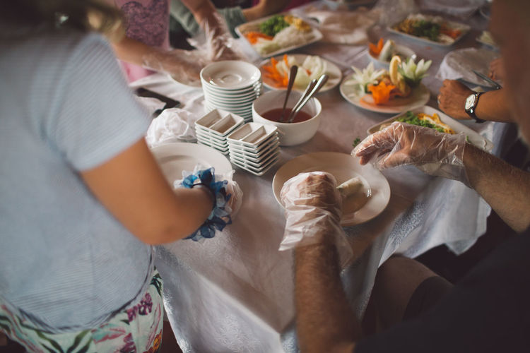 Vietnam Adult Breakfast Cup Drink Food Food And Drink Group Of People Hand Hanoi High Angle View Holding Human Hand Indoors  Lifestyles Meal Men Midsection People Real People Refreshment Sitting Table Women