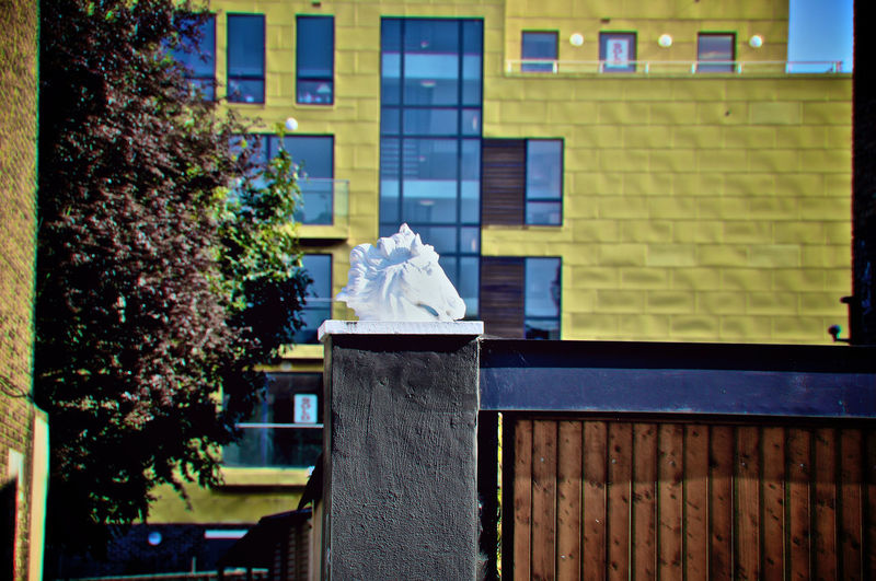 View of statue against building