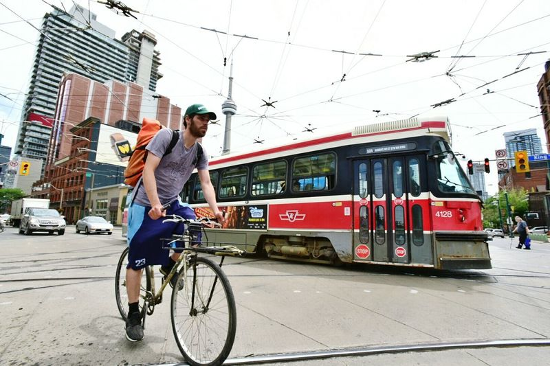 My city. Toronto Streetcar Bike Biker Cntower Spadinaandking The6ix Therocket EyeEmToronto Ttc EyeEm Best Shots - The Streets Streetphotography Streetphoto_color Ilovetoronto On The Way