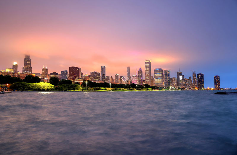 The Chicago skyline at night after a storm across Lake Michigan. Architecture Chicago Chicago, Illinois City Cityscape Downtown Chicago Illinois Lake Michigan Skyline Travel Downtown District Lake Night Travel Destinations