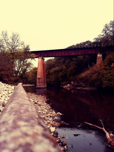 Such a peaceful place! Bridge - Man Made Structure Connection Outdoors No People Built Structure Architecture Iowariver By The River Iowa Pretty♡ Trainbridge Picturejunkie Check This Out Beauty In Nature Tranquil Scene Fishing Life Perspectives On Nature