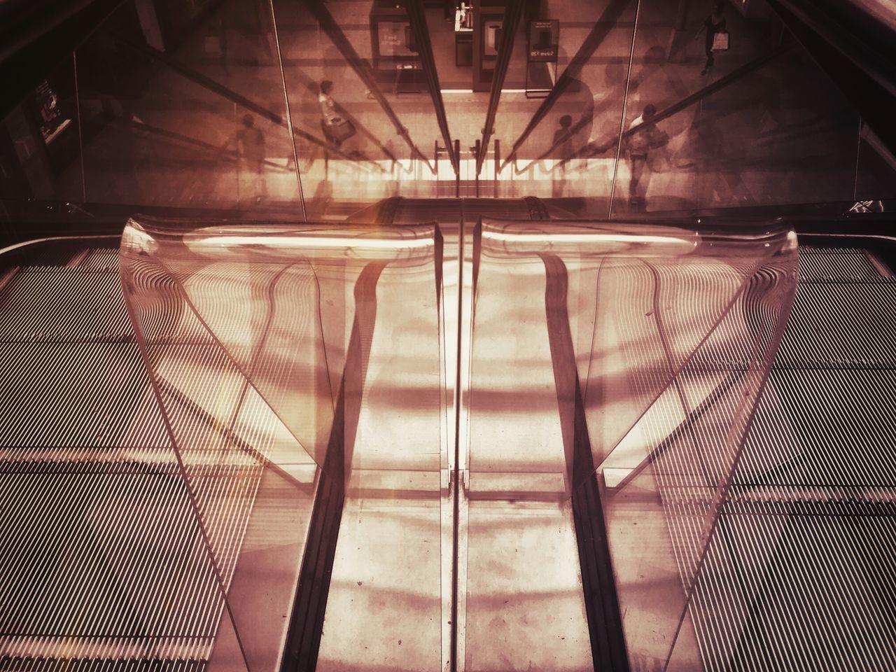 CLOSE-UP OF ILLUMINATED WINDOW OF EMPTY RAILROAD STATION