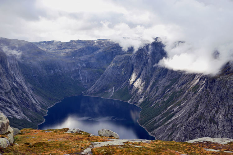 View along Trolltunga hike Norway Beauty In Nature Cloud - Sky Day Environment Formation Geology Idyllic Land Mountain Mountain Peak Mountain Range Nature No People Non-urban Scene Physical Geography Power In Nature Rock Scenics - Nature Sky Tranquil Scene Tranquility Trolltunga Norway Hiking Volcanic Crater Water