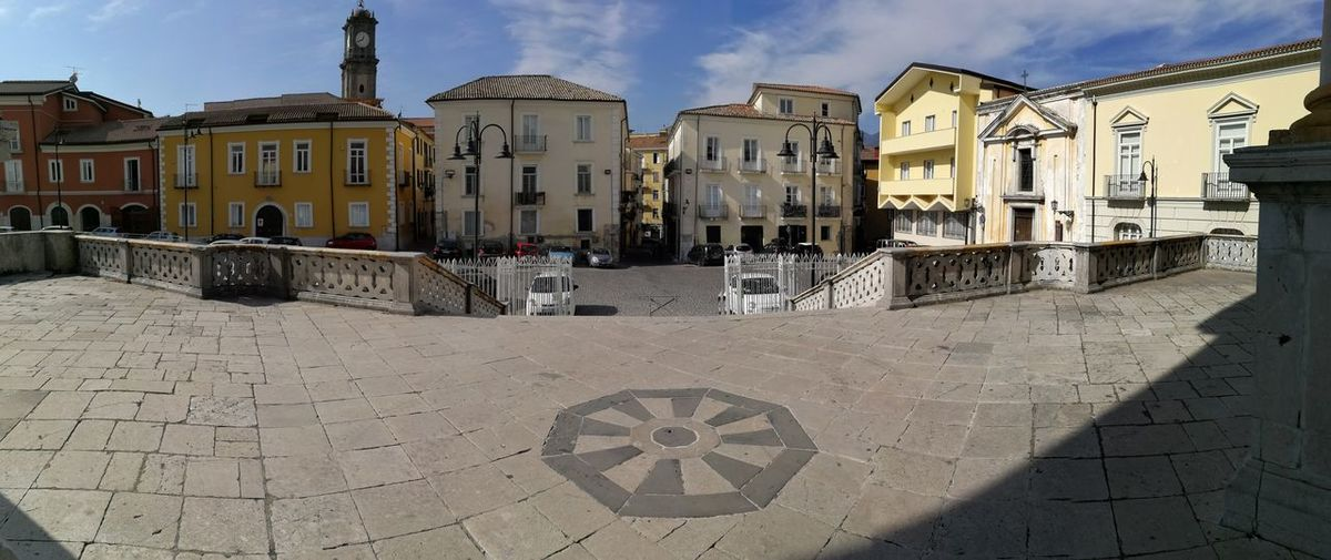 Building Exterior Architecture Built Structure Sky Building Cloud - Sky City Nature Day Sunlight Residential District Street Outdoors No People Footpath The Past Travel Destinations Old History Shadow Paving Stone Panorama Panoramic Photography Sagrato Duomo
