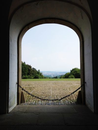 View to Ludwigsburg Solitude Schloss Solitude Stuttgart Window View Framed View From The Mountain High Over The City Arch City Sky Architecture Built Structure Pavilion Symmetry Gate City Gate Entrance Palace Calm