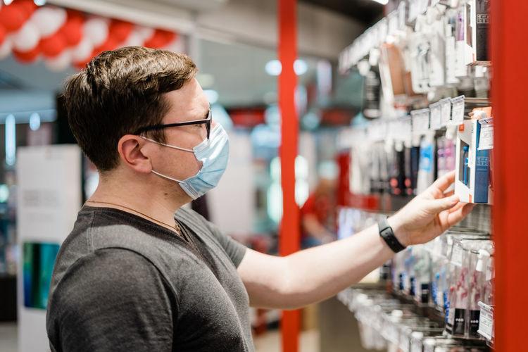 Man holding headphones in store