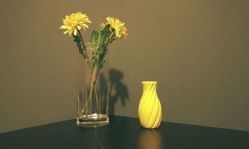 Close-up of yellow flower in vase on table