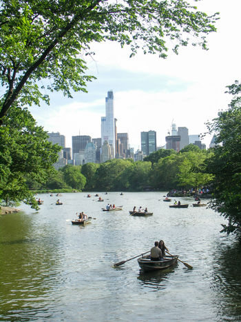 Central Park Rowing Architecture Building Exterior Built Structure City Day Growth Manhatan Men Mode Of Transport Nature Nautical Vessel Outdoors People Real People River Sailing Sky Skyscraper Transportation Tree Urban Skyline Water Waterfront
