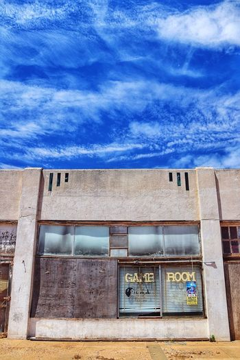 Abandoned game room and blue skies Downtown Abandoned Places West Texas Skies Blue Sky Game Room Lamesa TX Built Structure Building Exterior Architecture Day Sky Blue Nature No People Outdoors Cloud - Sky Sunlight Window Building Low Angle View City