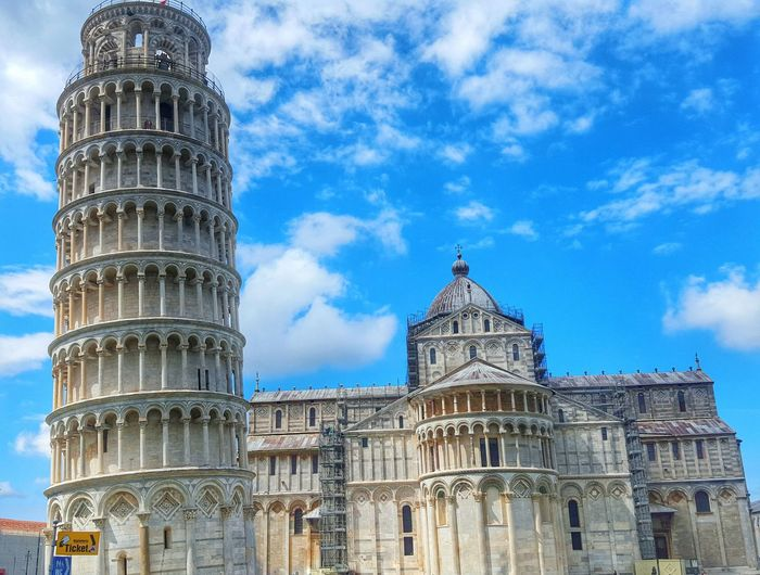 Low angle view of leaning tower against sky