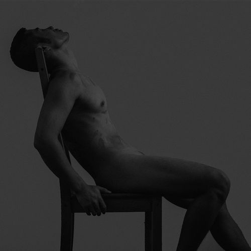 Naked Man Against Gray Background