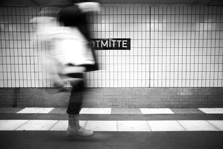 Blurred Motion Of Person Walking In Subway Station