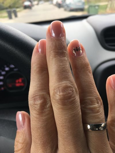 Close-up of woman hand in car