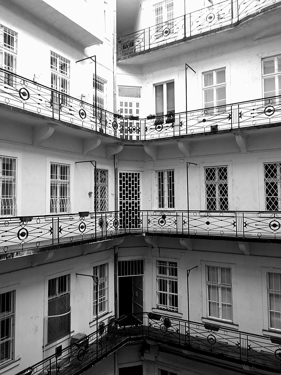building exterior, architecture, built structure, window, building, residential district, balcony, no people, railing, low angle view, day, city, outdoors, nature, apartment, side by side, full frame, communication, house, connection