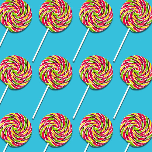 Full Frame Shot Of Colorful Lollipops Against Blue Background