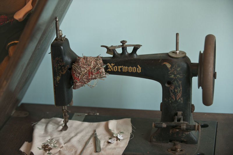 Close-up of old machinery on table