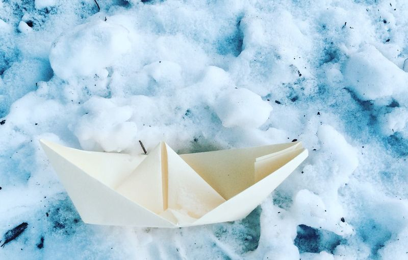 Close-up of paper boat on snow